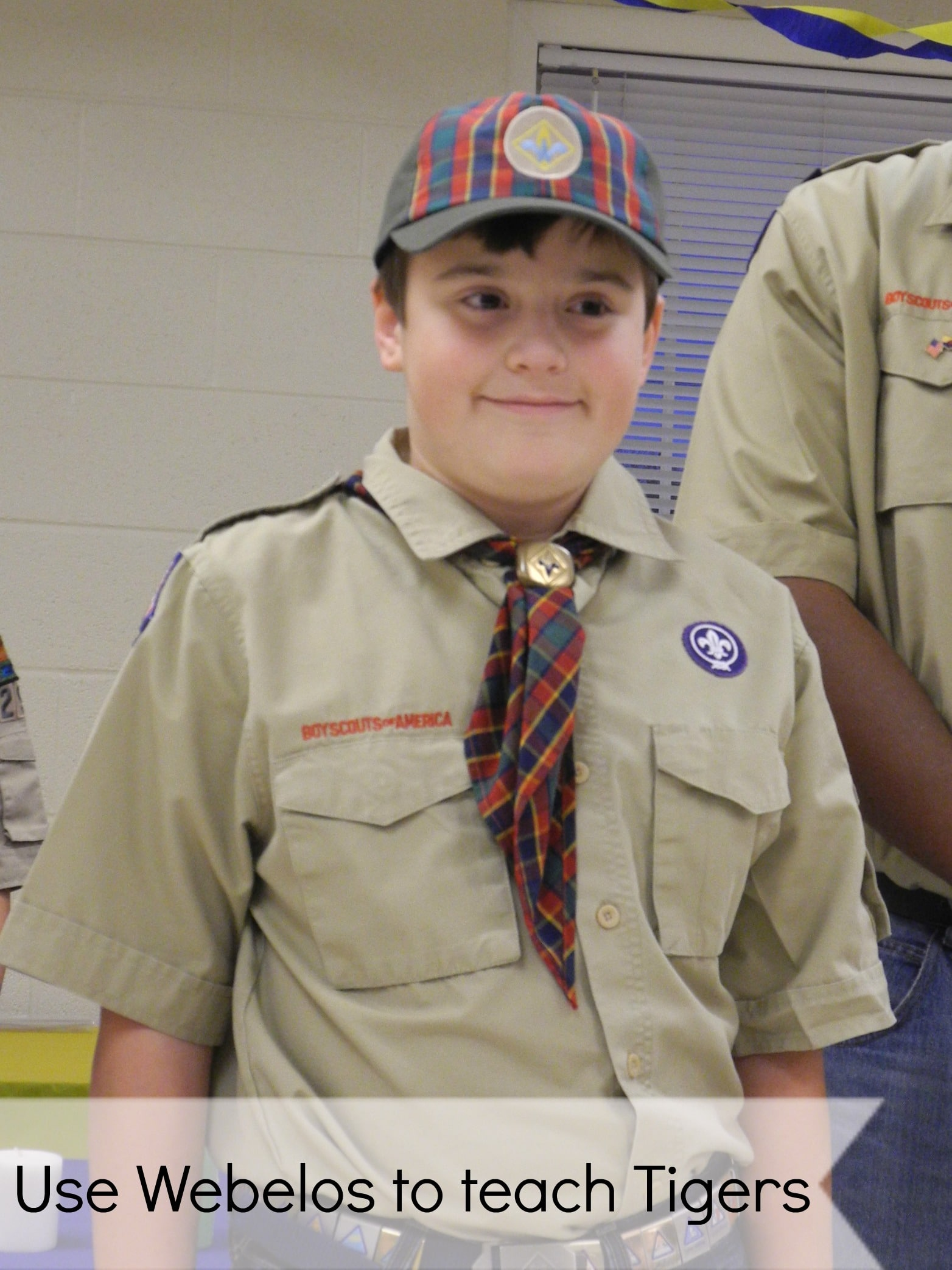 cub scout using webelos to teach tigers
