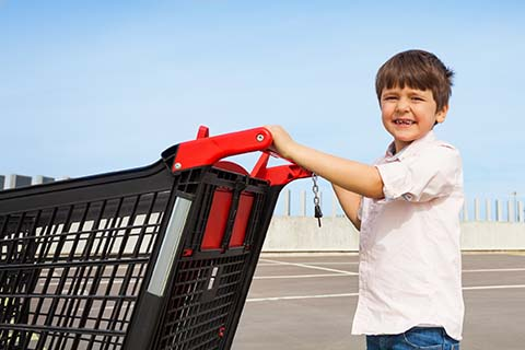 boy pushing shopping cart