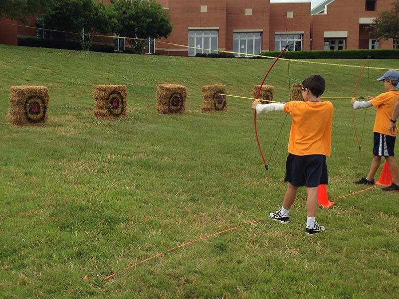 olahraga menembak panahan scout cub