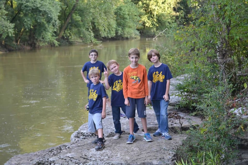 cub scouts outdoors by creek