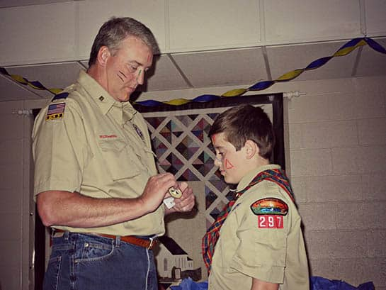 Awarding a Cub Scout rank badge