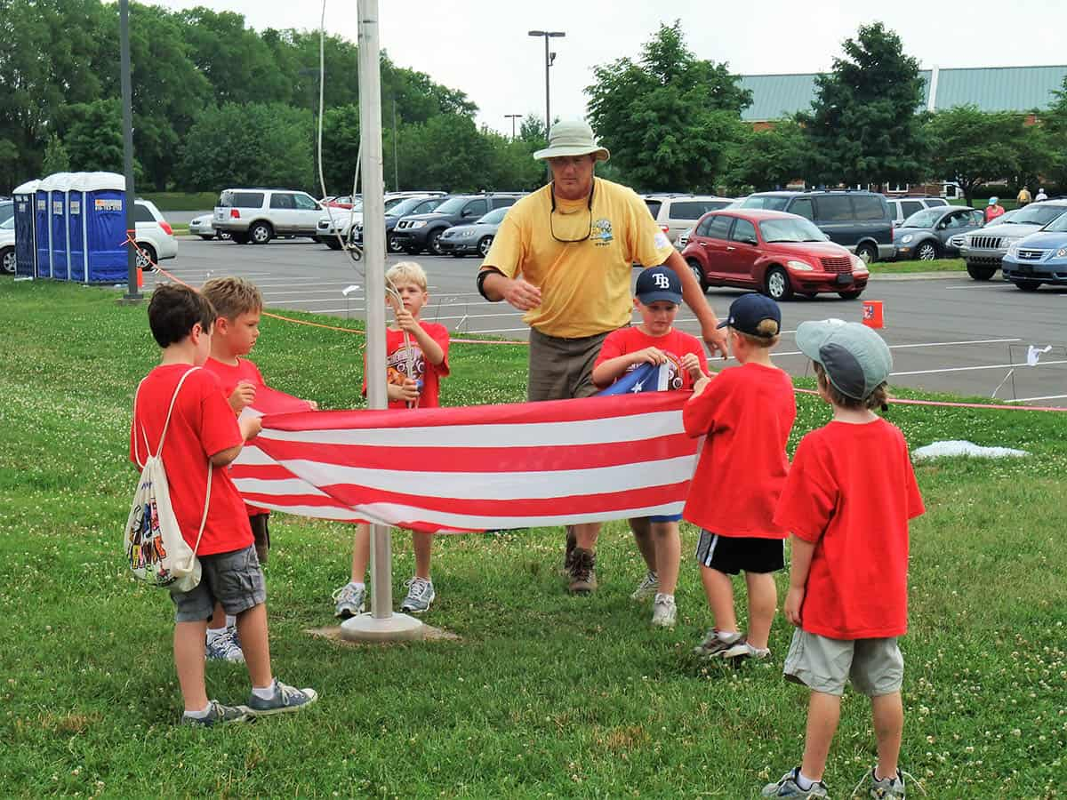 learning to fold flag at cub scout day camp