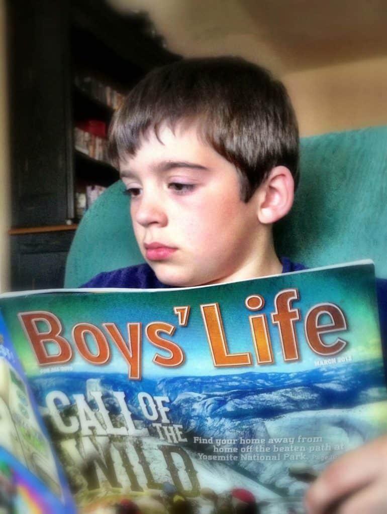 boy reading boys' life magazine