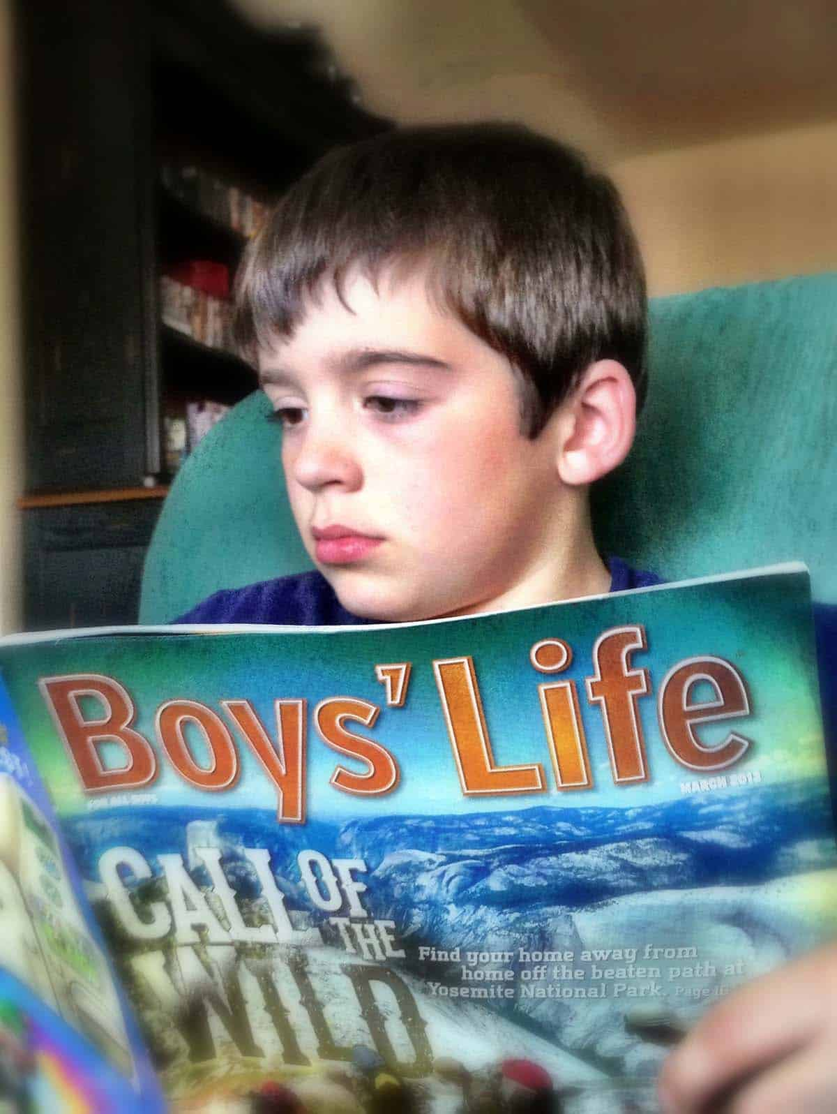 boy reading boys' life magazine