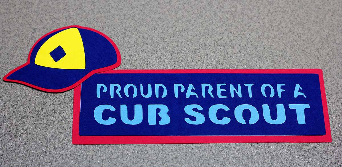 Cub Scout hat and proud parent sign made with Cricut