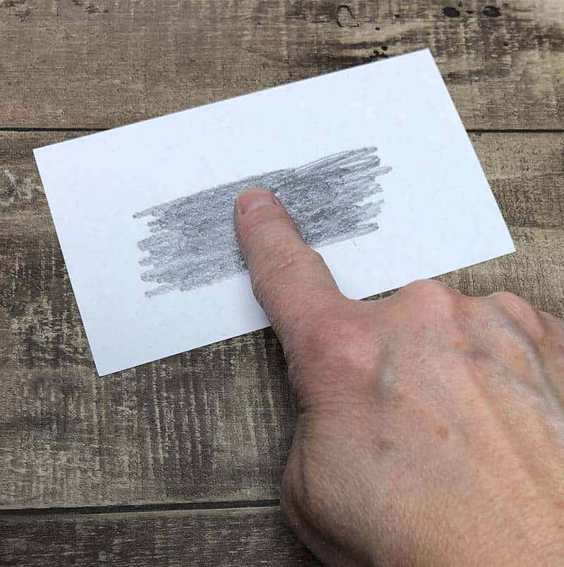 rub finger on pencil graphite for fingerprinting activity