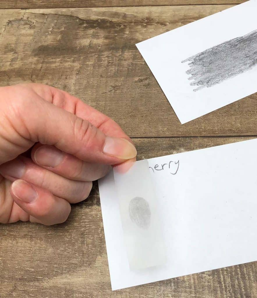 tape with fingerprint on index card