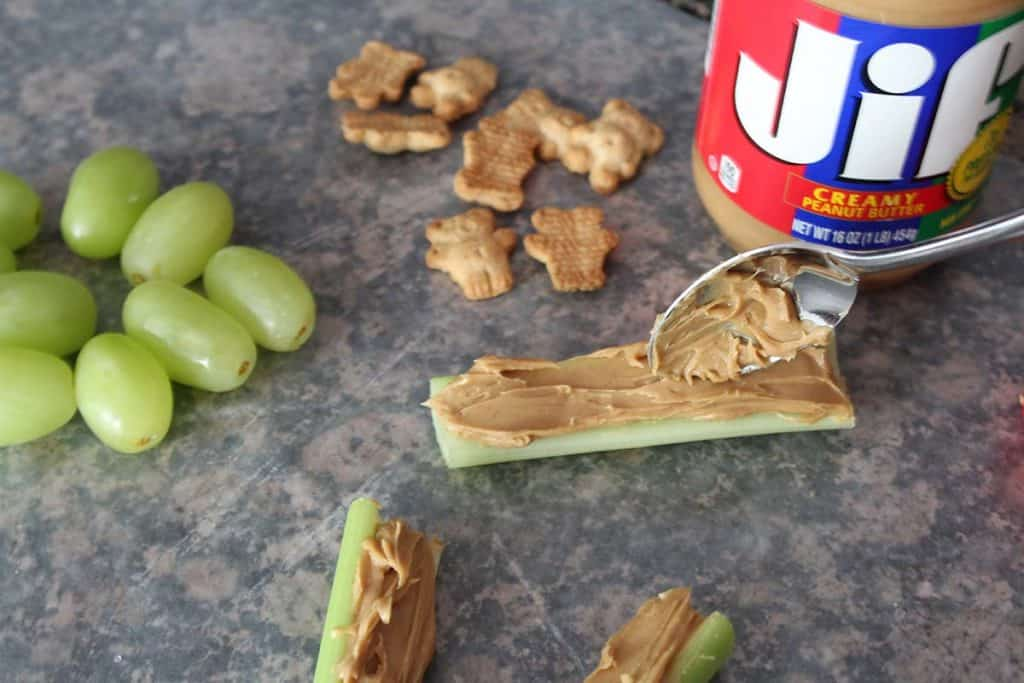 assembly of celery peanut butter healthy pinewood derby snack