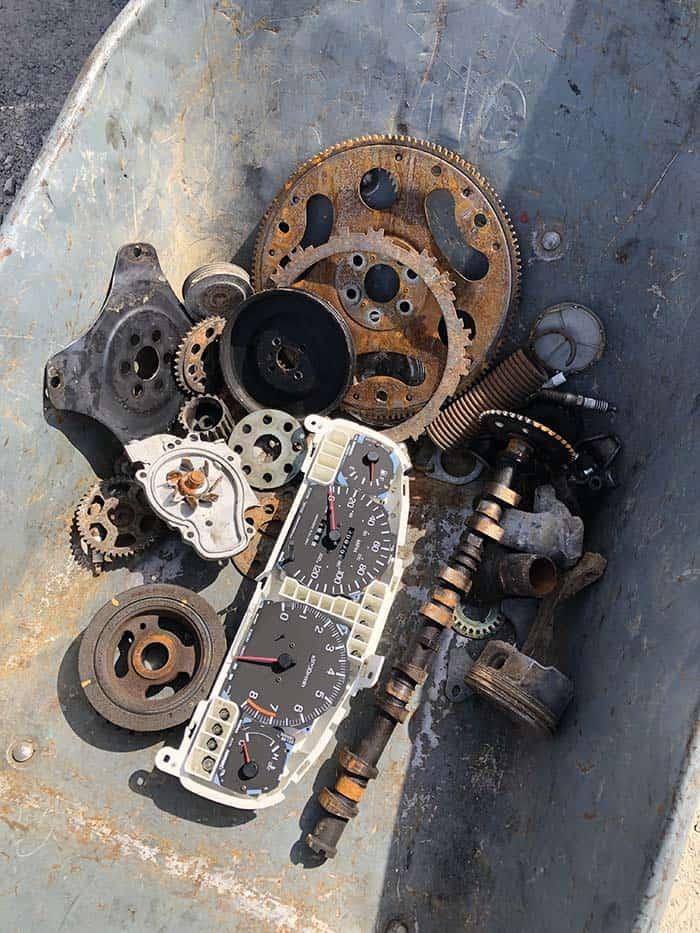 wheelbarrow of car parts for pinewood derby awards