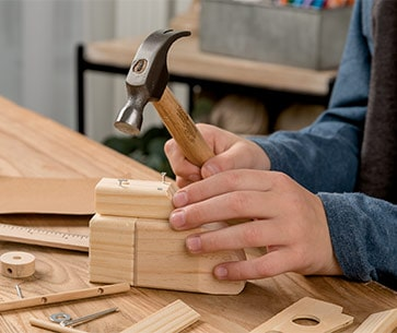 young woodworkers kit club child hammering