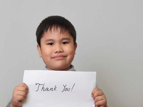 boy with thank you note