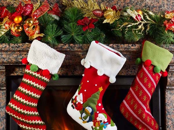 christmas stockings on mantle rustic